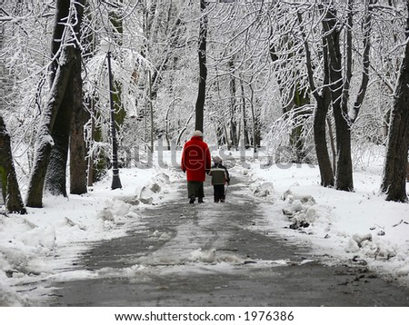 Walking in the park in winter - stock photo