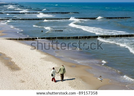 Walking in the sand of a beach - stock photo