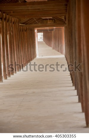 walking in the temple, surrounded by a wooden red.