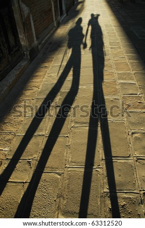 Walking lovers shadow