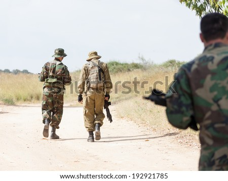 walking military weapons, summer day