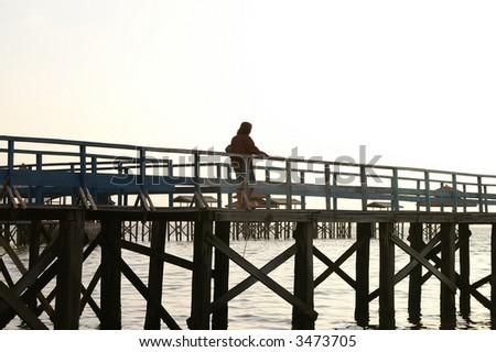 walking on dock - stock photo