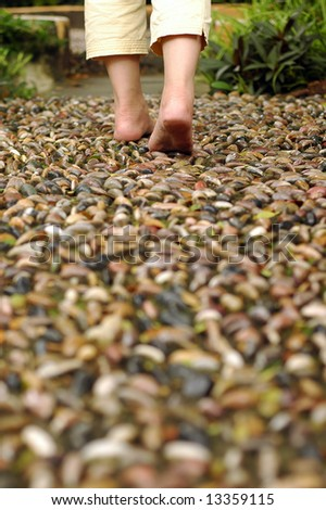 Walking on reflexology path - stock photo