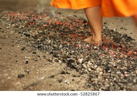 Walking on the burning cinders - stock photo