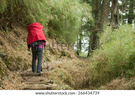 walking on the path in the mountain - stock photo