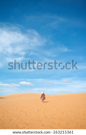 Walking on the red sand dunes. Mui Ne, Vietnam - stock photo