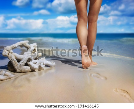 Walking on the sand - stock photo