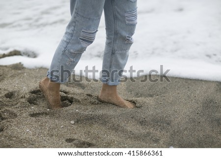 """walking on the sand. The ease of mind. Woman enjoying the sea breeze , sea and sand . Smiles , do not think of """"tomorrow"""" . - stock photo"""
