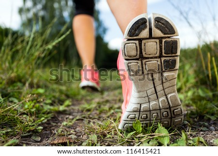 Walking or running legs in forest, adventure and exercising in summer nature - stock photo