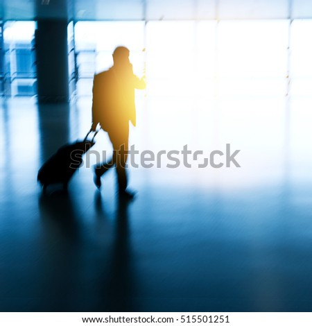 Walking passenger at the airport, motion blur.