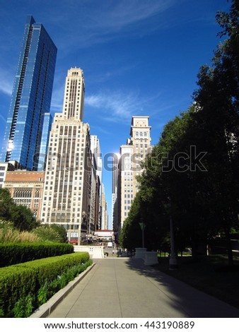Walking path in Chicago park with skyline view