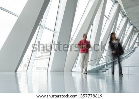 walking people in office building - stock photo