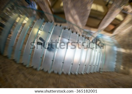 Walking people on a modern staircase, view from underneath. - stock photo