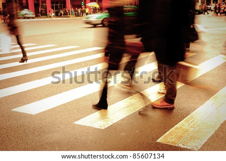 walking people on zebra crossing street blur motion - stock photo