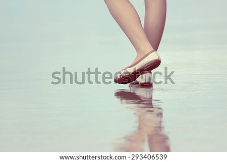 Walking people, Reflections of walking on the beach - stock photo