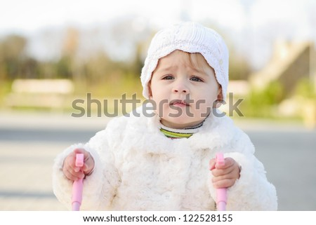 walking serious baby  with stroller - stock photo