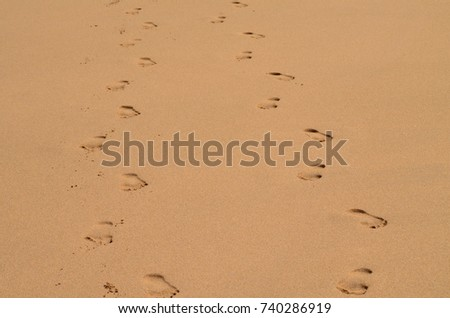 Walking side by side barefoot in the sand on a Hawaiian sandy beach