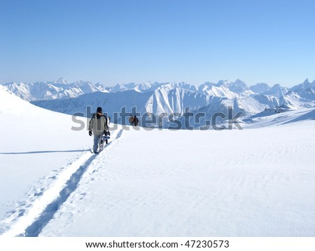 walking snowboarders - stock photo