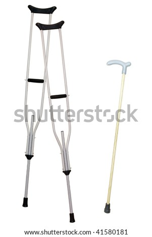 walking stick and crutches under the light background - stock photo