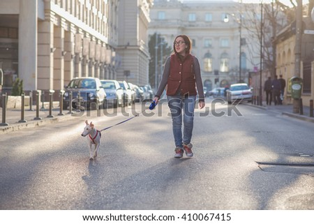 Walking through the city with the dog