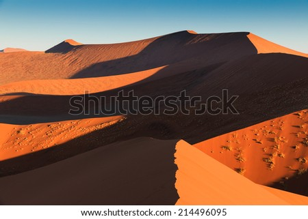 Walking to the end of red dune 45. Sossusvlei, Namibia, Africa. - stock photo