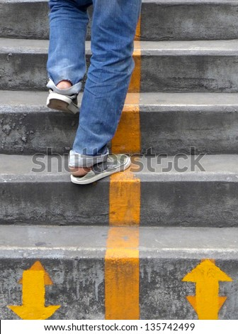 Walking up the stairs - stock photo