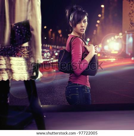 Walking woman looking at shop window - stock photo