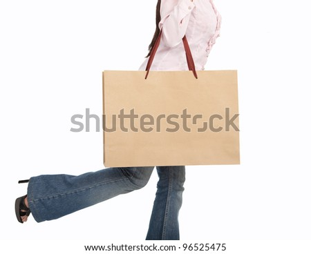 walking woman with large shopping bag