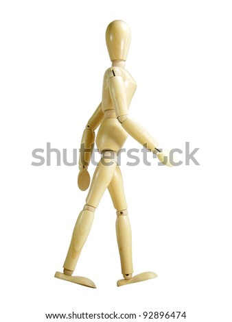 Walking wood puppet isolated over white background - stock photo