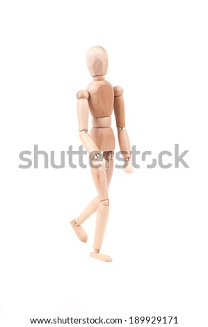 Walking wooden model. Isolated on white background