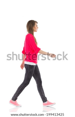 Walking young woman, side view. Full length studio shot isolated on white. - stock photo