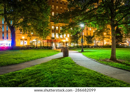 Walkway and buildings at night, at Rittenhouse Square in Philadelphia, Pennsylvania. - stock photo