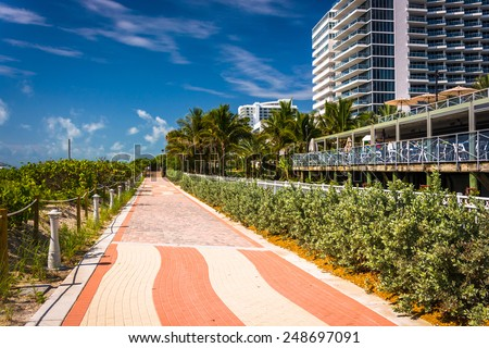 Walkway and buildings in Miami Beach, Florida. - stock photo
