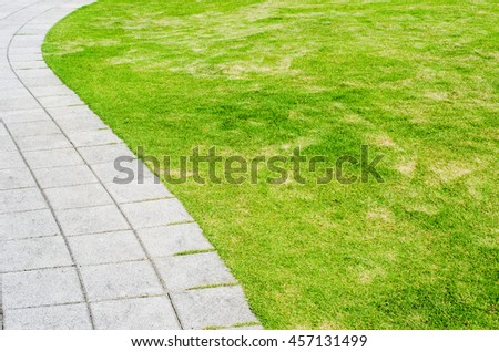 Walkway and green grass field