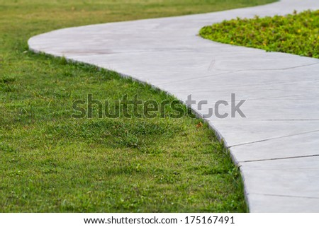 walkway and green grass in the park