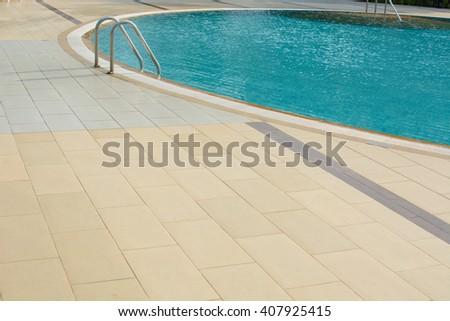 walkway beside swimming pool - stock photo