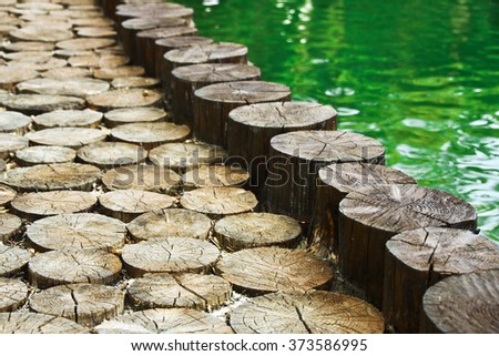 walkway circular slabs of wood - stock photo