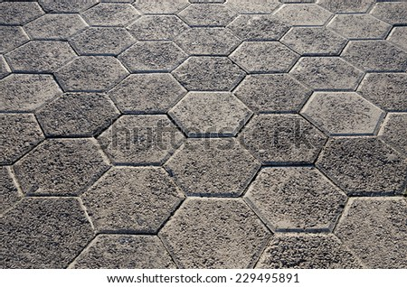 Walkway from gray concrete tiles - stock photo