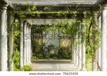 Walkway in magical floral garden - stock photo