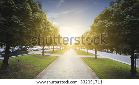 Walkway in the city on sunset - stock photo