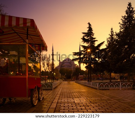 Walkway in the square near Sultan Ahmed mosque at sunset. Istanbul, Turkey - stock photo