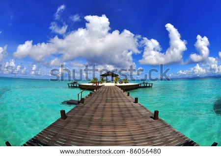 walkway Kapalai island peace in the middle of the ocean - stock photo