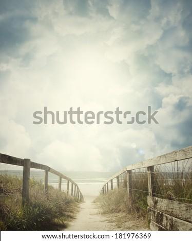 Walkway leading to beach scene - stock photo