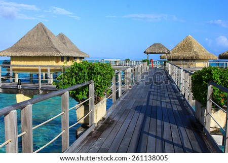 Walkway leading to over the water bungalows in Bora Bora - stock photo