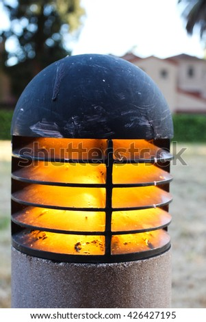 Walkway light with some houses in the background. - stock photo