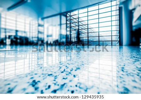walkway of the shanghai airport,interior of the modern building - stock photo