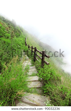 Walkway on the mountain in the fog, Chiang mai Thailand - stock photo