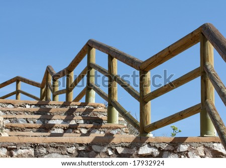 Walkway - some steps with a wooden handrail