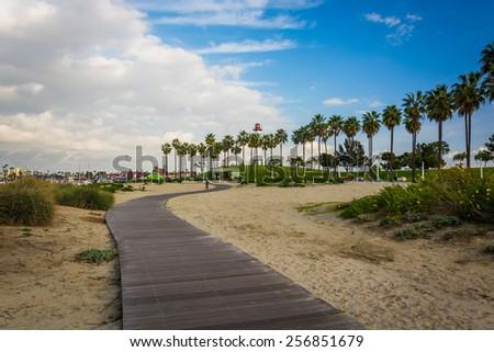 Walkway through sand at Shoreline Aquatic Park, in Long Beach, California. - stock photo