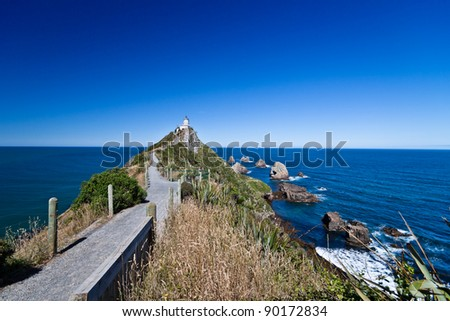 Walkway to Nugget Point Lighthouse. New Zealand. - stock photo